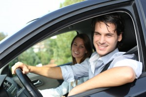 Cheerful-couple-driving-car
