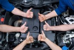 Automotive Technicians with Thumbs up in Engine Compartment